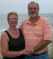 Picture of Gail & Harlan Banks standing beside the ocean.